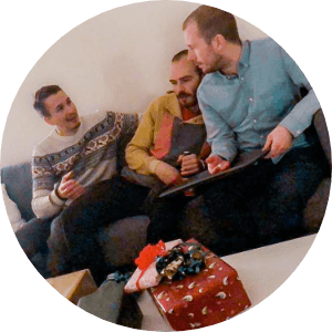 Three guys sitting in a couch